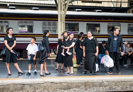 Bangkok, Thailand - September 23, 2017: Mourners waiting for their train home at Hua Lamphong Station in Bangkok after having paid their last respect to the late King Bhumipol who died 13 October 2016 and will be cremated 26 October 2017. Editorial