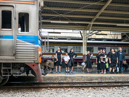 cremated: Bangkok, Thailand - September 23, 2017: Mourners waiting for their train home at Hua Lamphong Station in Bangkok after having paid their last respect to the late King Bhumipol who died 13 October 2016 and will be cremated 26 October 2017. Editorial
