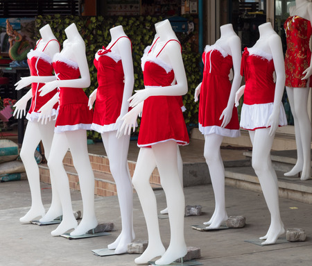 Santa Claus costumes for bar hostesses for sale on the street in Pattaya, Thailand, famous for its many go-go bars and enterntainment venues.