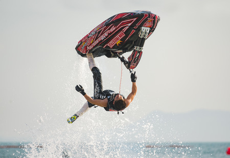 Pattaya, Thailand - December 9, 2017: Taiji Yamamoto from Japan during his performance at the freestyle competition during the International Jet Ski World Cup at Jomtien Beach, Pattaya, Thailand.