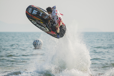 Pattaya, Thailand - December 9, 2017: Norio Fukada from Japan during his performance at the freestyle competition during the International Jet Ski World Cup at Jomtien Beach, Pattaya, Thailand.