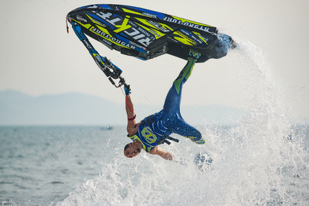 Pattaya, Thailand - December 9, 2017: Mark Gomez from USA during his performance at the freestyle competition during the International Jet Ski World Cup at Jomtien Beach, Pattaya, Thailand. Editorial