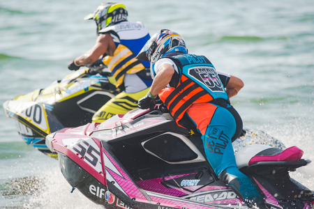 Pattaya, Thailand - December 9, 2017: Teruhisa Imai from Japan and Chaowalit Kuajaroon from Thailand at the start of the Pro Runabout 1100 Superstock Class of the International Jet Ski World Cup at Jomtien Beach, Pattaya, Thailand. Editorial