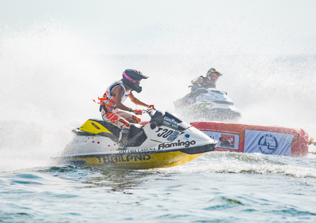 Pattaya, Thailand - December 9, 2017: Terry Tee from Malaysia and Ekachon Kingchansilp from Thailand competing in the Pro Runabout 1100 Superstock Class of the International Jet Ski World Cup at Jomtien Beach, Pattaya, Thailand. Editorial