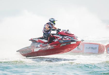 Pattaya, Thailand - December 9, 2017: Aero Sutan Aswar from Indonesia competing in the Pro-Am Runabout Stock Class of the International Jet Ski World Cup at Jomtien Beach, Pattaya, Thailand.