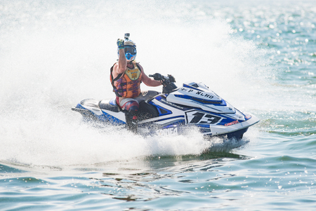 Pattaya, Thailand - December 9, 2017: Pancho Marjak from Finland celebrating victory in the Pro-Am Runabout Stock Class of the International Jet Ski World Cup at Jomtien Beach, Pattaya, Thailand.