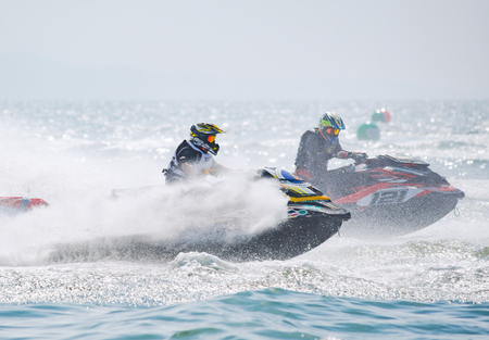 Pattaya, Thailand - December 9, 2017: Supahlak Ninnopparat from Thailand and Adrian Wilson from the UK, competing in the Pro-Am Runabaout Open Class of the International Jet Ski World Cup at Jomtien Beach, Pattaya, Thailand.