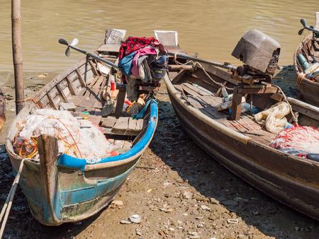 Small, traditional fishing vessels along Dala River near Yangon.