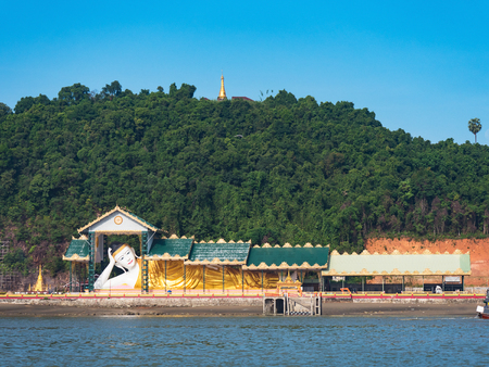 Reclining Buddha, Atula Shwethalyaung, on Pahtaw Pahtet Island in Myeik, Tanintharyi Region, South Myanmar. The Buddha image is hollow, and on the inside there's a walkway with images depicting the life of Buddha.