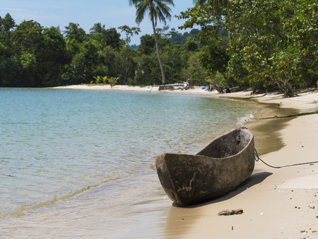 Simple sea gypsy, canoe made from one piece of wood on a beach at Dome Island outside Myeik, a part of the Mergui or Myeik Archipelago in the Tanintharyi Region of Southern Myanmar. The Moken lifestyle is constantly under pressure by tourism and infrastructure developments.
