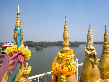 Small stupas at Wat Hong Tong, a Buddhist temple out in the sea in the Chachoengsao Province of Thailand. Mangrove forest is visible in the background. Stock Photo