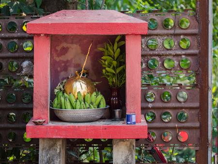 Tiny, roadside Buddhist shrine in Yangon, Myanmar Stock Photo