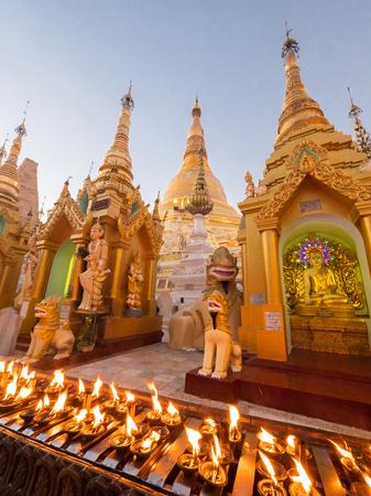 Oil lamps lit by visitors to the Shwedagon Pagoda in Yangon, Myanmar.