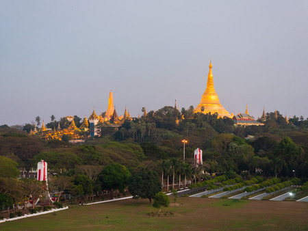 The floodlighted Shwedagon Pagoda in Yangon, Myanmar just after sunset with the People's Park in the foreground. Stock Photo