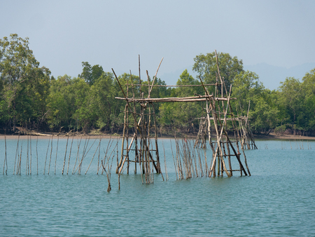 Primitive fish trap along a canal on Kala Island at the Myeik Archipelago, formerly the Mergui Archipelago, in the Tanintharyi Region of Myanmar. Stock Photo