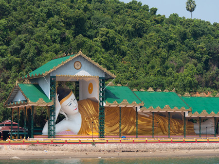 Large reclining Buddha on Pataw Island in Myeik Archipelago, formerly the Mergui Archipelago, in the Tanintharyi Region of Myanmar. Pataw Island is just a ten minutes boat ride from the city of Myeik. Stock Photo