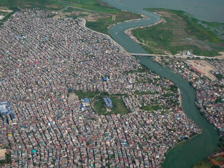 Aerial photo of Nagpayong and Pasig River in Pasic City, Metro Manila, the Philippines. Stockfoto