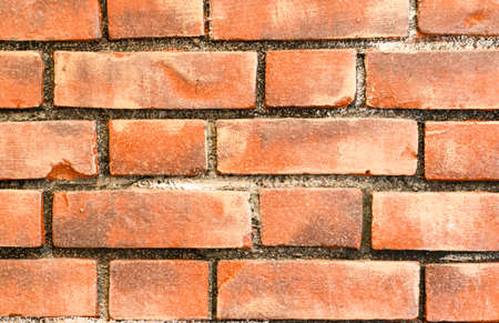building material: Background of old brick wall. Building material and stone structures Stock Photo