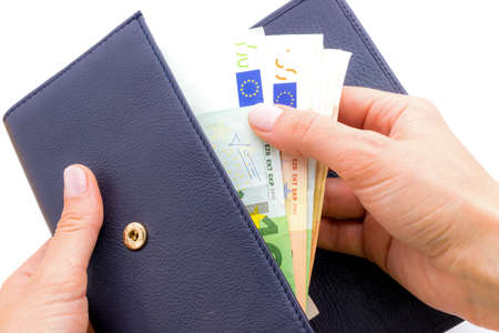 billfold: Blue purse with euros in the hands isolated on a white background Stock Photo