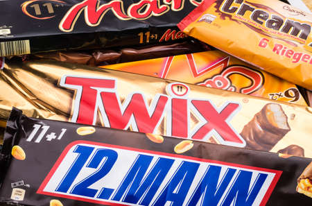snickers: Germany - June 21, 2016: different sweets. Candy heap. Snickers, Mars Twix Cream Empty calories
