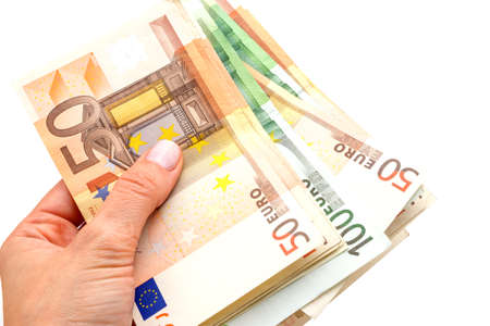 billfold: Euros in the hands isolated on a white background Stock Photo