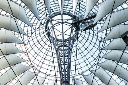 sony: BERLIN, GERMANY - JUNE 22, 2016: Futuristic modern design roof at Sony Center, Potsdamer Platz, Berlin, Germany.