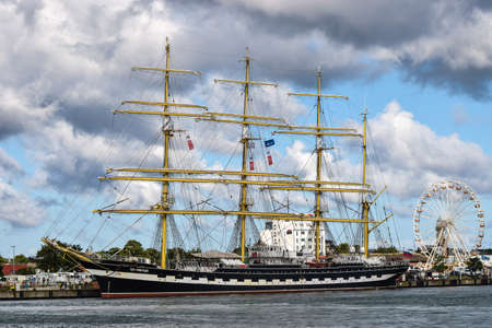 Rostock, Germany - August 2016: Kruzenshtern or Krusenstern is a four-masted barque. Hansesail in Warnemuende and Rostock harbor.