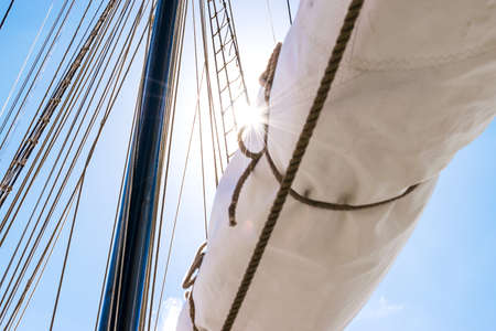 shroud: Mast, sails and shroud of a tall ship. Rigging detail.