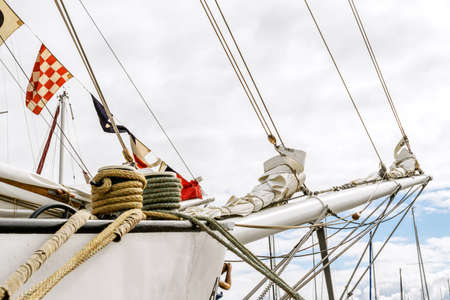 Bowsprit and rope coiled up of the sailing ship.