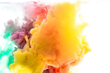 Yellow, blue, aquamarine, pink, green acrylic colors. Ink swirling in water. Color explosion Stock Photo