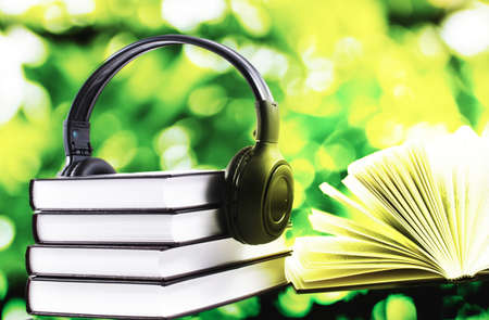 books with headphones. Audio book concept