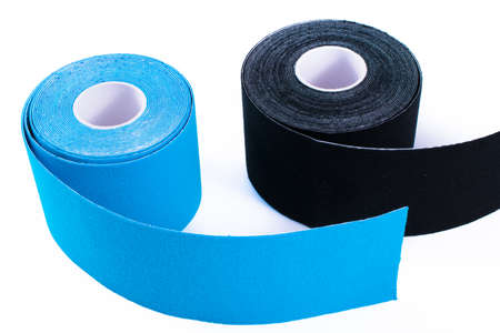 black and blue kinesiology tape. Physiotherapy and therapeutic tape for wrist pain, aches and tension. elastic therapeutic tape. adhesive tape and alternative medicine.