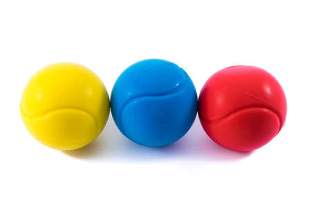 Yellow,blue and red stressballs.Physiotherapy and  alternative medicine.