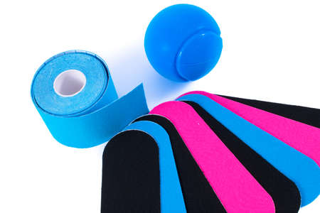 colorful kinesiology tape and stressball. Physiotherapy and therapeutic tape for wrist pain, aches and tension. elastic therapeutic tape. adhesive tape and alternative medicine.