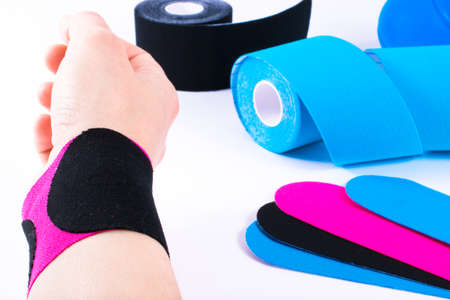 taping: hand with kinesiology tape. Physiotherapy and therapeutic tape for wrist pain, aches and tension. elastic therapeutic tape. adhesive tape and alternative medicine.