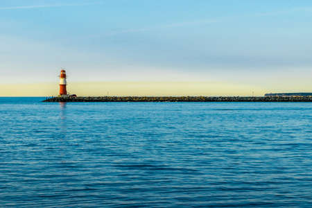 red lighthouse of Warnemuende on the Baltic Sea at the harbor ,
