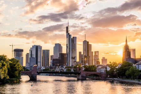 central european: Frankfurt at Main skyline in the evening at sunset. Financial center of Germany. Stock Photo