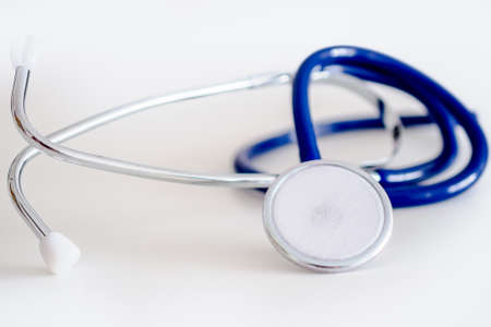 blue stethoscope on white table