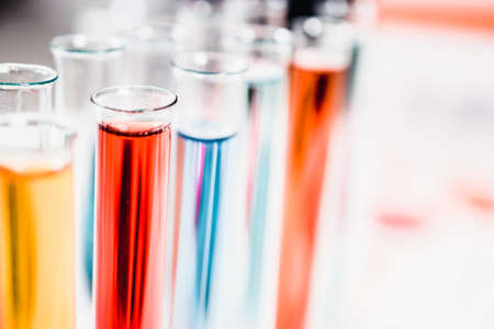 test tubes in laboratory. drug discovery, pharmacology and biotechnology concept. science and medical research background.