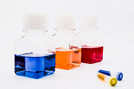 Chemical tubes and flasks with colorful liquids and reagents. Medical laboratory research. drug discovery, pharmacology and biotechnology concept. science and research background with copy space. Stock Photo