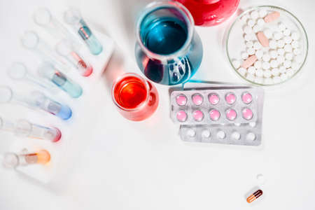 pills and test tubes in laboratory. drug discovery, pharmacology and biotechnology concept. science and medical research background with copy space. Stock Photo