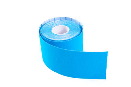 blue kinesiology tape. Physiotherapy and therapeutic tape for wrist pain, aches and tension. elastic therapeutic tape. adhesive tape and alternative medicine. Stock Photo