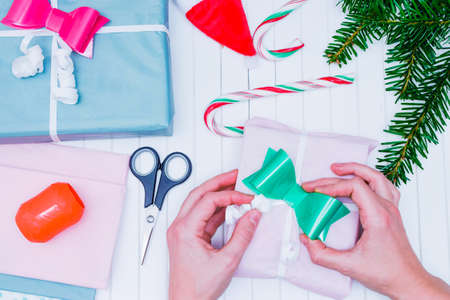 Womens Hands Wrap A Christmas Present. Christmas Gift Wrapping ...