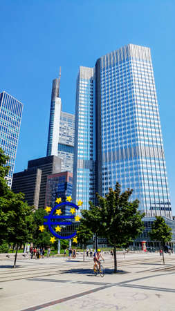 Frankfurt, Germany - July 27, 2017: Business and finance district in Frankfurt am Main. Euro sign at European Central Bank headquarters
