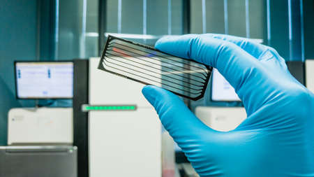 Frankfurt, Germany - July 27, 2017: Scientist with DNA Sequencing Chip. Medical laboratory.