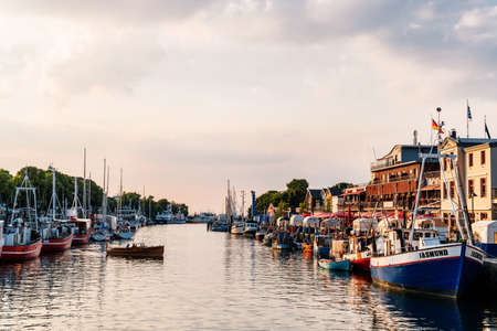 Rostock, Germany - Juny 20, 2018: canal with ships and Baltic Se 新聞圖片