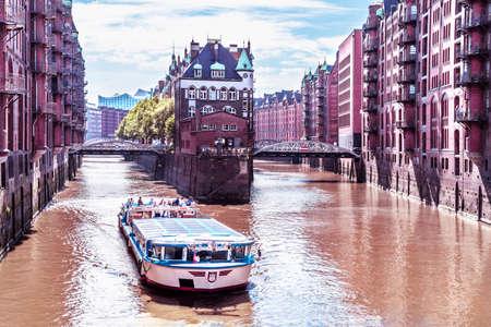 Rostock, Hamburg - July 3, 2018: Hamburg warehouse district with tourist ship