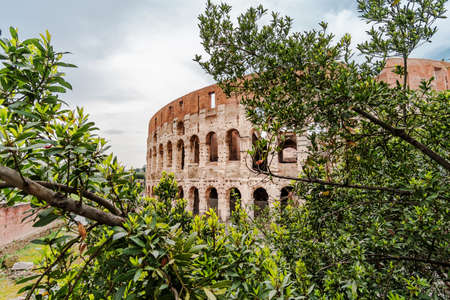 Roma, Italy - april 17, 2018: Colosseum in Rome. Italy capital landmarks. Colosseum or Amphitheatrum Flavium , a vast amphitheater in Rome. Travel, tourism and attractions
