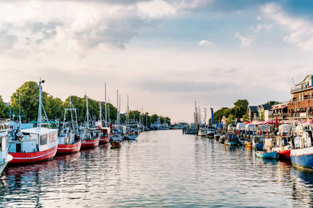 Rostock, Germany - Juny 20, 2018: canal with ships and Baltic Sea in Warnemuende, Rostock Germany