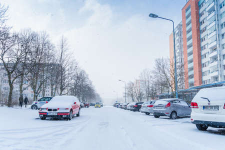 Rostock, Germany - april 24, 2018: snow covered car drives in winter storm